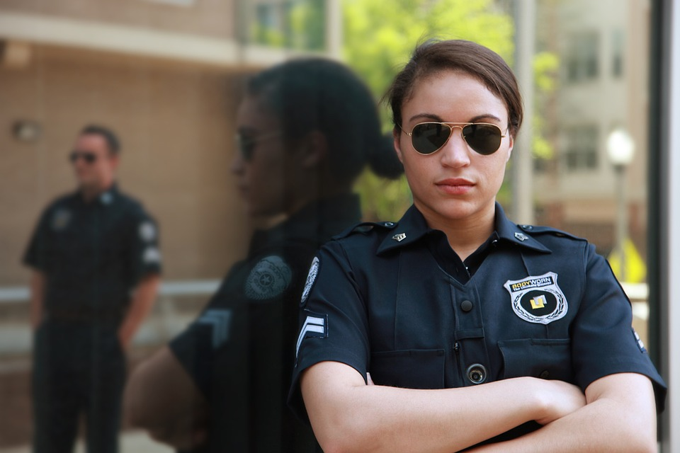 female police officer with body camera