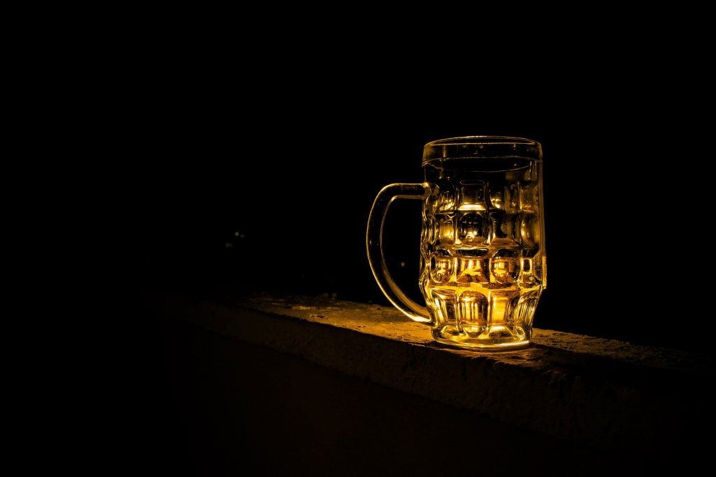 Picture of a pint of beer on a bar.